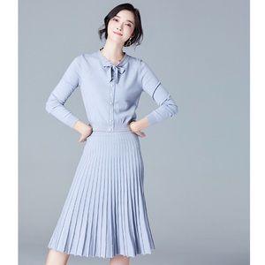 Pale blue woolen knitwear pleated skirt suit